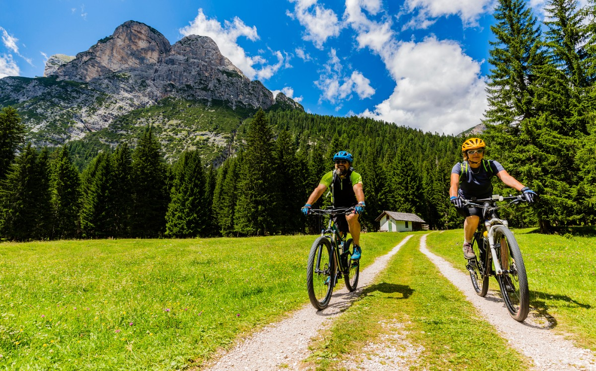 bigstock-Mountain-biking-family-with-bi-231936139